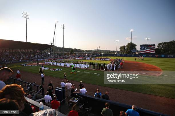 Little League baseball players stand with the Pittsburgh Pirates and the St Louis Cardinals before the inaugural MLB Little League Classic at BBT...
