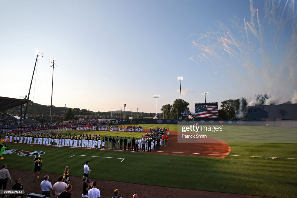Little League baseball players stand with the Pittsburgh Pirates and the St. Louis Cardinals before the inaugural MLB Little League Classic at BB&T Ballpark at Historic Bowman Field on August 20, 2017 in Williamsport, Pennsylvania.