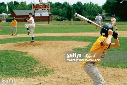 Little League batter awaiting pitch : Stock Photo