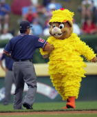 Little League mascot Dugout does the 'chicken dance'' with field umpire Richard Ota during the International final on August 28 2004 during the...