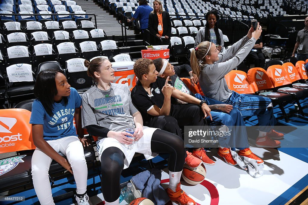Little League Pitcher Mo'ne Davis poses for a selfie with Lindsay Whalen #13, assistant coach Shelley Patterson, Seimone Augustus #33 and Tricia Liston #20 of the Minnesota Lynx prior to the WNBA Western Conference Finals Game 2 on August 31, 2014 at Target Center in Minneapolis, Minnesota.