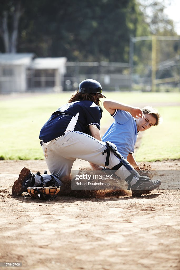 Little league player sliding to to home base. : Stock Photo