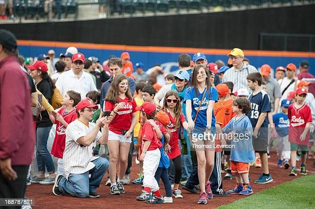 Little Leaguers take a lap around the field before the game against the Pittsburgh Pirates on May 10 2013 at Citi Field in the Flushing neighborhood...