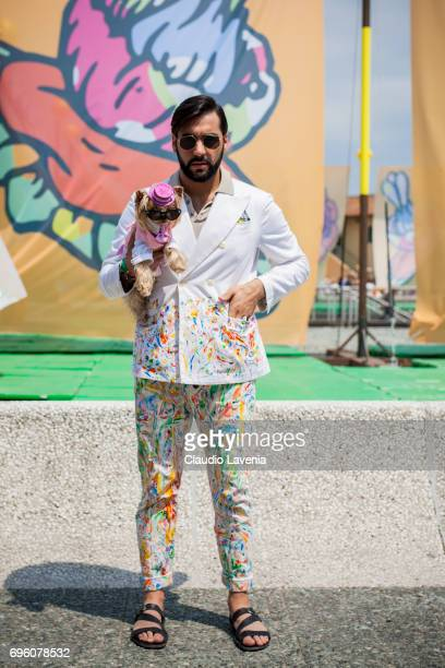 Little Lola Sunshine the dog and Paolo Roda are seen during Pitti Immagine Uomo 92 at Fortezza Da Basso on June 14 2017 in Florence Italy