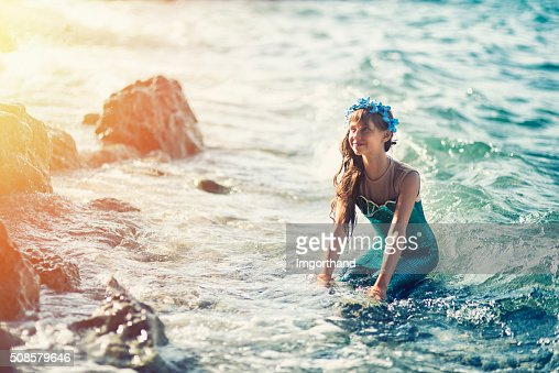 Little mermaid at the shore : Stock Photo