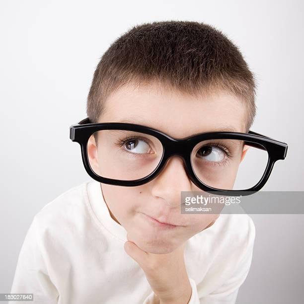 Little Nerd Boy Wearing Large Black Glasses And Thinking