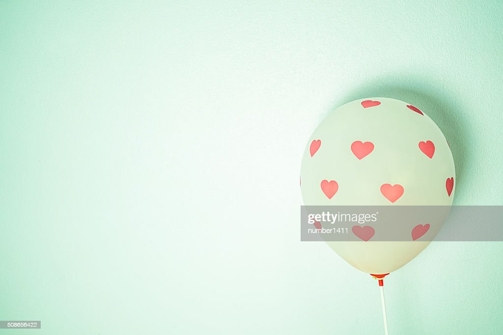 little pink heart on balloon for romantic background : Stock Photo