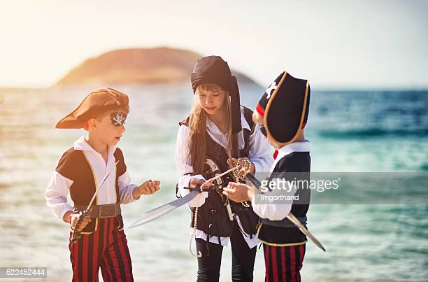 Little pirate kids diving the treasure