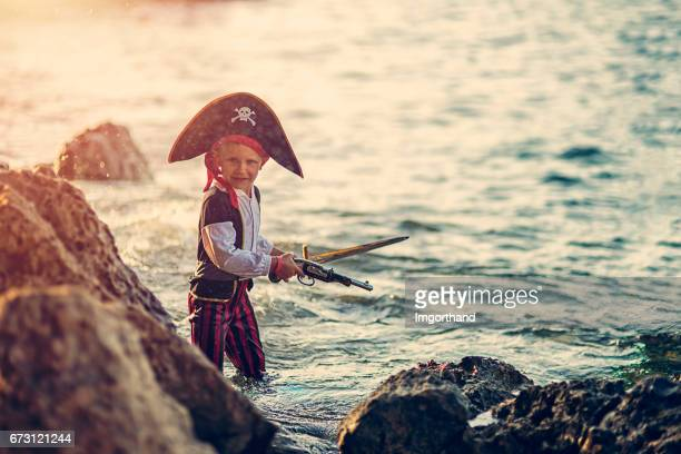 Little pirate looking for a cave to hide his treasure