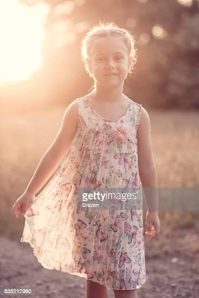 Little princess wearing beautiful dress and smiling