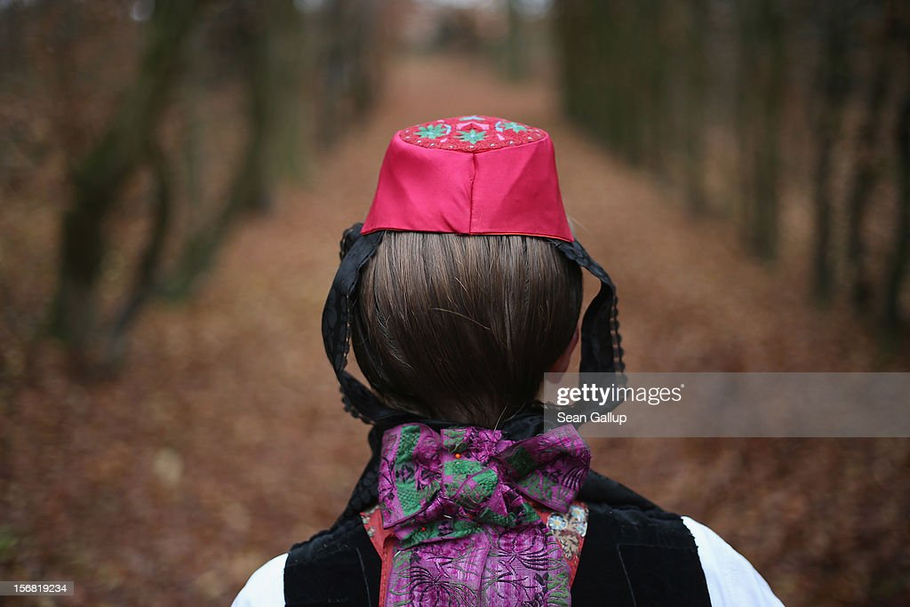 Rotkaeppchen, which translates to Little Red Cap), actually actress Dorothee Weppler, wears the local Schwalm region folk dress with its red cap as she walks through a forest on the estate of Baron von Schwaerzel on November 20, 2012 in Willingshausen, Germany. Little Red Riding Hood is one of the many stories featured in the collection of fairy tales collected by the Grimm brothers, and the two reportedly first came across the story while staying on the von Schwaerzel estate. The 200th anniversary of the first publication of Grimms' Fairy Tales will take place this coming December 20th. The Grimm brothers collected their stories from oral traditions in the region between Frankfurt and Bremen in the early 19th century, and the works include such global classics as Sleeping Beauty, Rapunzel, The Pied Piper of Hamelin, Cinderella and Hansel and Gretel.