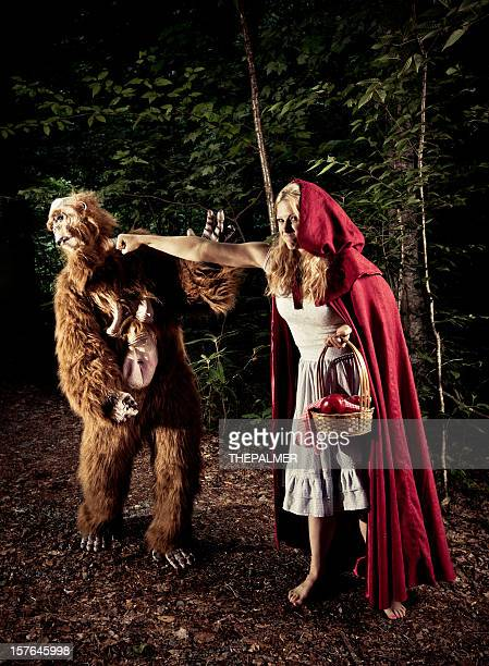 Little Red Riding Hood punching bigfoor in the face