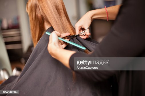 Little Red-Haired Girl Getting Haircut in Salon