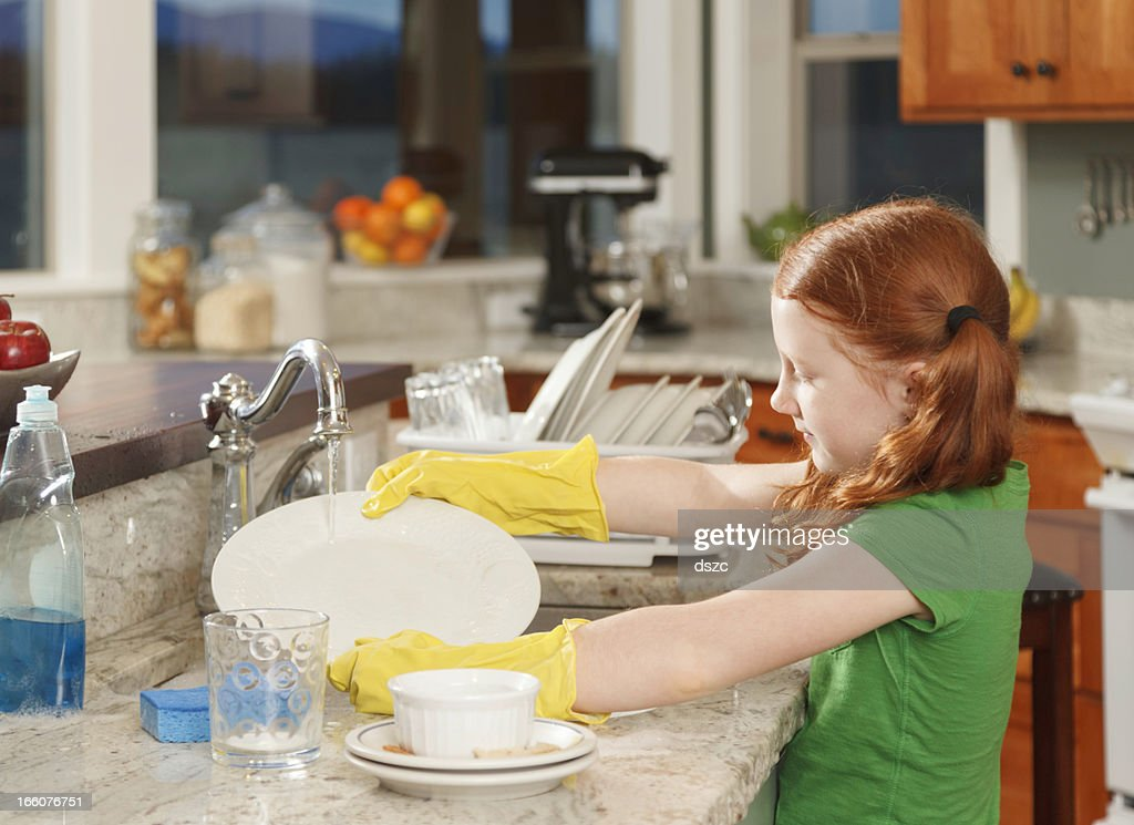 Kitchen Sink With Dishes little redhaired girl washing dishes in kitchen sink at home stock