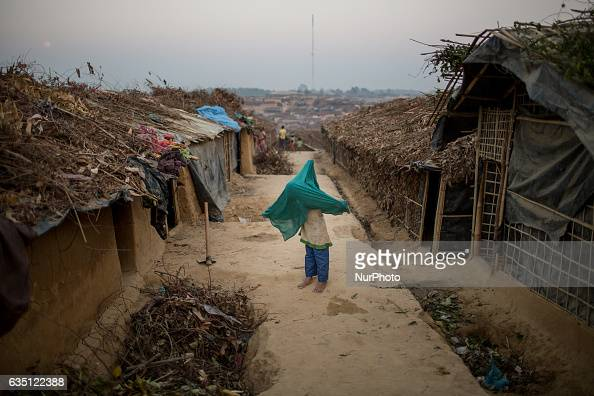 A little Rohingya girl fixes her scarf at Kutupalong Refugee Camp Cox's Bazar Bangladesh on February 13 2017 After attacks by Rohingya militants on...