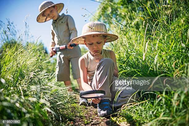 Little safari boys exploring the dangerous bushes