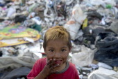 A little scavenger boy smiles at the 'Bordo Poniente' garbage dump in Mexico City on January 18 2012 Some six thousand tons of garbage from the...