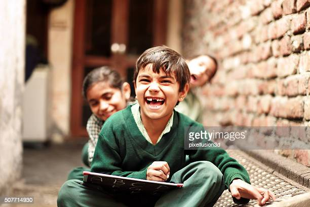 Little School Students laughing portrait at home