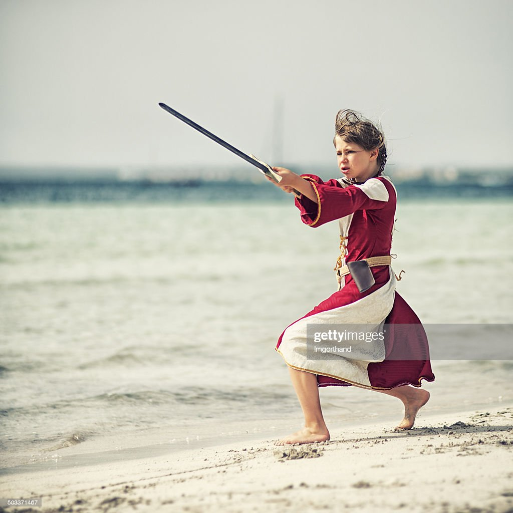 Little shieldmaiden practicing : Stock Photo