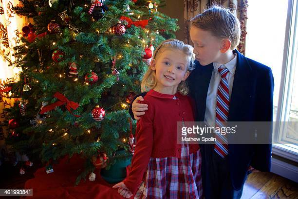 Little siblings in front of the Christmas tree