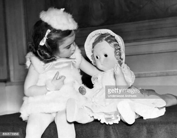 Little Simone Myers with her doll which was the 'Queen Mary's Prize' at the Peter Pan Party at the Claridge's Hotel today London England May 1 1939...