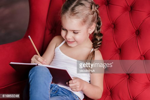 Little smiling girl drawing : Stock Photo