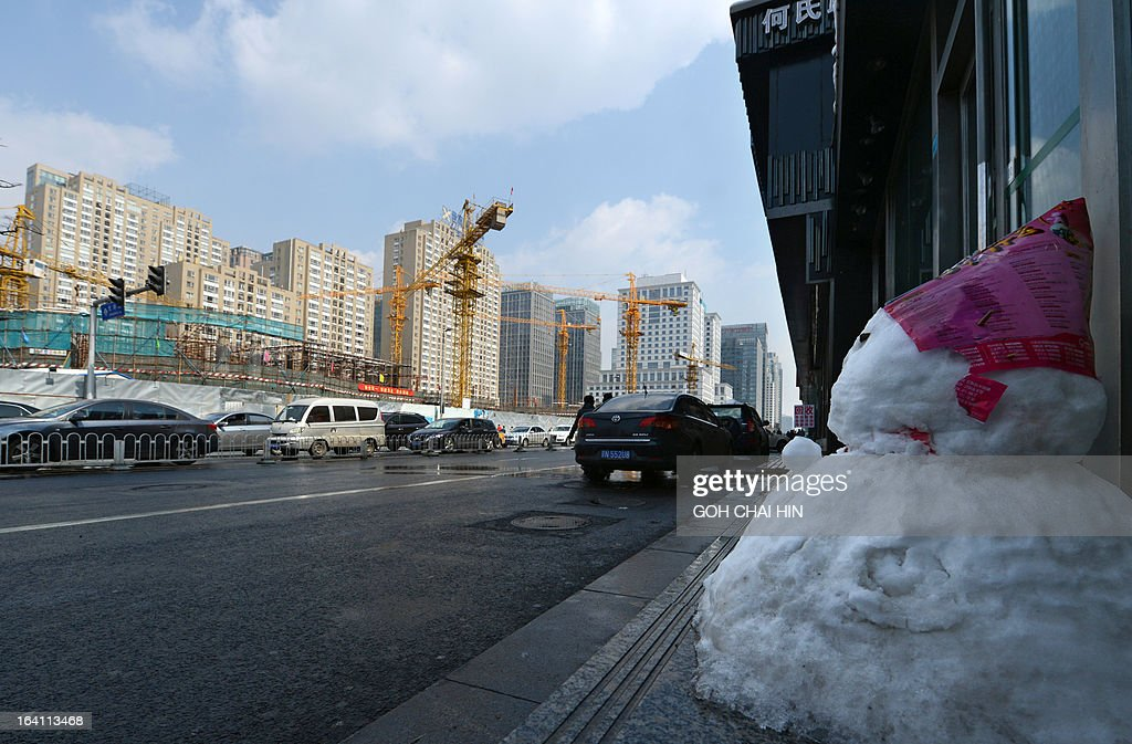 A little snowman (R) is left by a street after an overnight snowfall in Beijing on March 20, 2013. The spring snowfall brought some relieve to Chinese city officials as during recent bouts of pollution, the capital has seen particulate levels almost 40 times World Health Organisation (WHO) limits, and the pollution is inflicting a heavy toll on both human health and economic activity.
