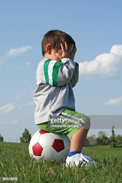 Poco niño de fútbol