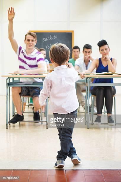 Little teacher in his classroom