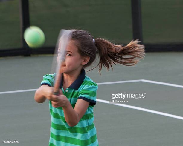 Little Tennis Player with Eye on the Ball