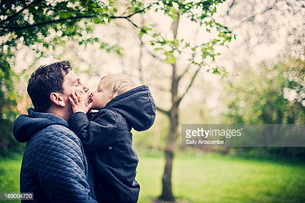 Little toddler boy giving his Daddy a kiss