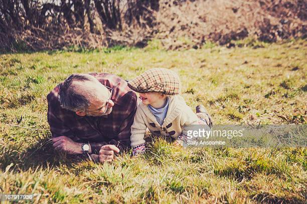 Little toddler girl with her grandpa