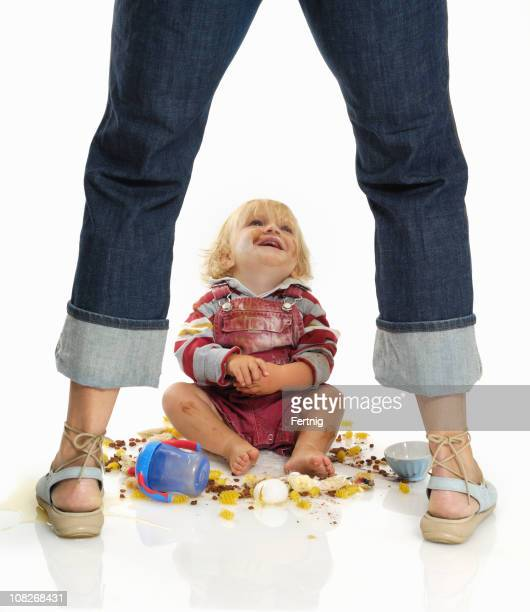 Little Toddler Looking Up at Mother and Making Mess
