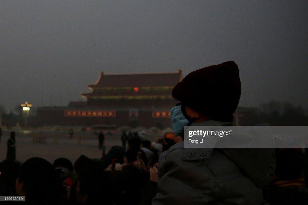 A little tourist wearing the mask visits the Tiananmen Square at dangerous levels of air pollution on January 13, 2013 in Beijing, China. Heavy smog shrouded Beijing with pollution at hazardous levels from January 12.