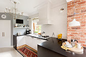 White and red brick in little trendy kitchen