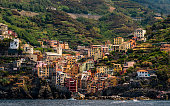 little village on steep hill in italy coast