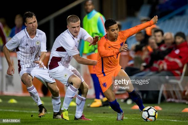Litvinskis Viktors of Jong Letland Justin Kluivert of Jong Oranje during the EURO U21 2017 qualifying match between Netherlands U21 and Latvia U21 at...