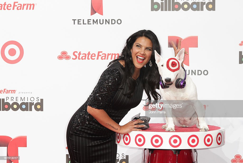 Litzy celebrates with Bullseye, Target's Beloved Bull Terrier Mascot, at the 2013 Billboard Latin Music Awards at BankUnited Center on April 25, 2013 in Miami, Florida.