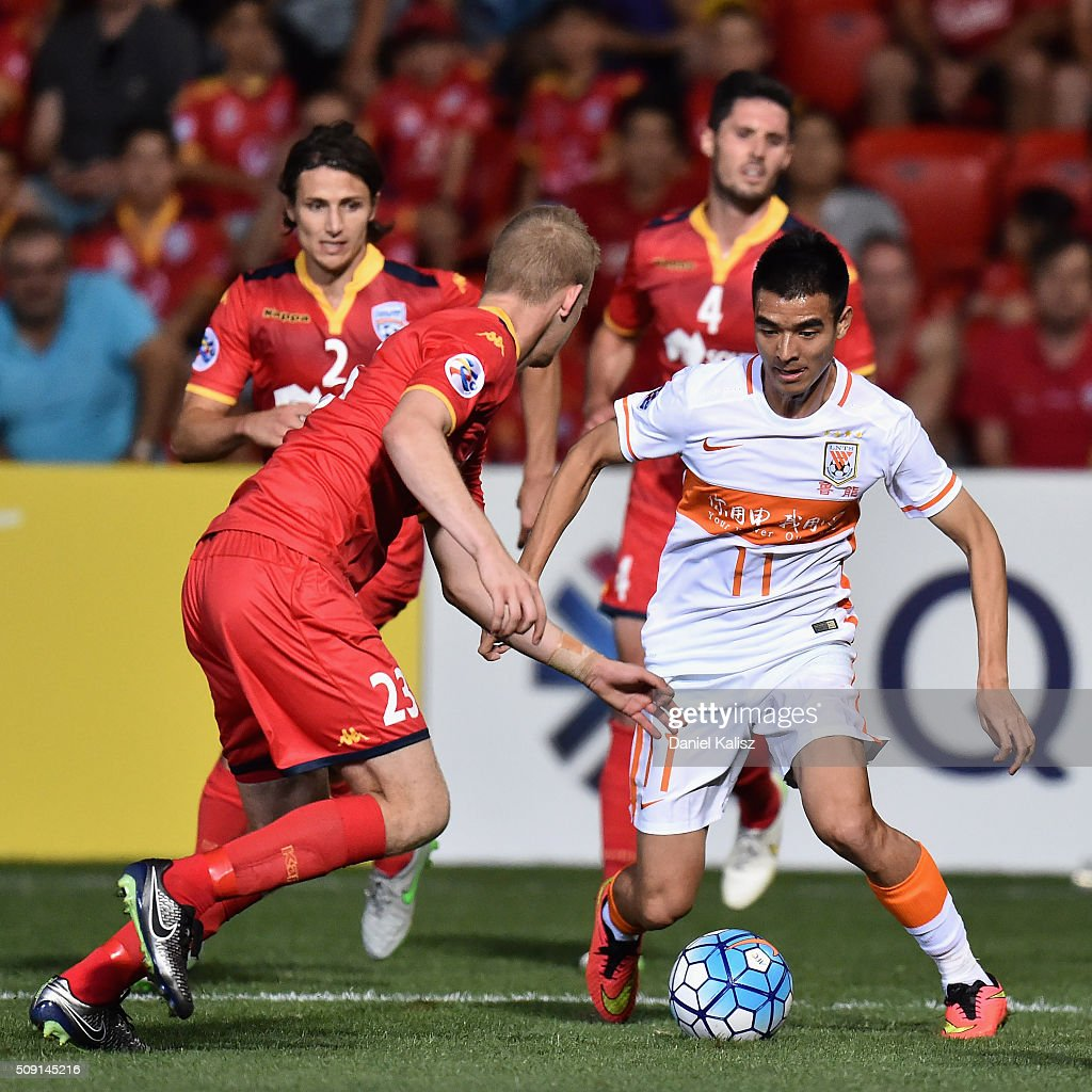 Liu Binbin of Shandong Luneng competes for the ball during the AFC Champions League playoff match between Adelaide United and Shandong Luneng at Coopers Stadium on February 9, 2016 in Adelaide, Australia.