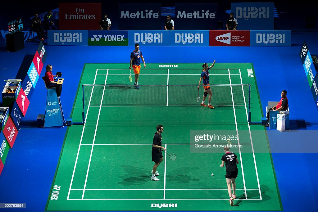 Liu Cheng and <a gi-track='captionPersonalityLinkClicked' href=/galleries/search?phrase=Bao+Yixin&family=editorial&specificpeople=8308329 ng-click='$event.stopPropagation()'>Bao Yixin</a> of China celebrate in the Mixed Doubles match against <a gi-track='captionPersonalityLinkClicked' href=/galleries/search?phrase=Joachim+Fischer+Nielsen&family=editorial&specificpeople=5851511 ng-click='$event.stopPropagation()'>Joachim Fischer Nielsen</a> and <a gi-track='captionPersonalityLinkClicked' href=/galleries/search?phrase=Christinna+Pedersen&family=editorial&specificpeople=5933396 ng-click='$event.stopPropagation()'>Christinna Pedersen</a> of Denmark during day two of the BWF Dubai World Superseries 2015 Finals at the Hamdan Sports Complex on December 10, 2015 in Dubai, United Arab Emirates.