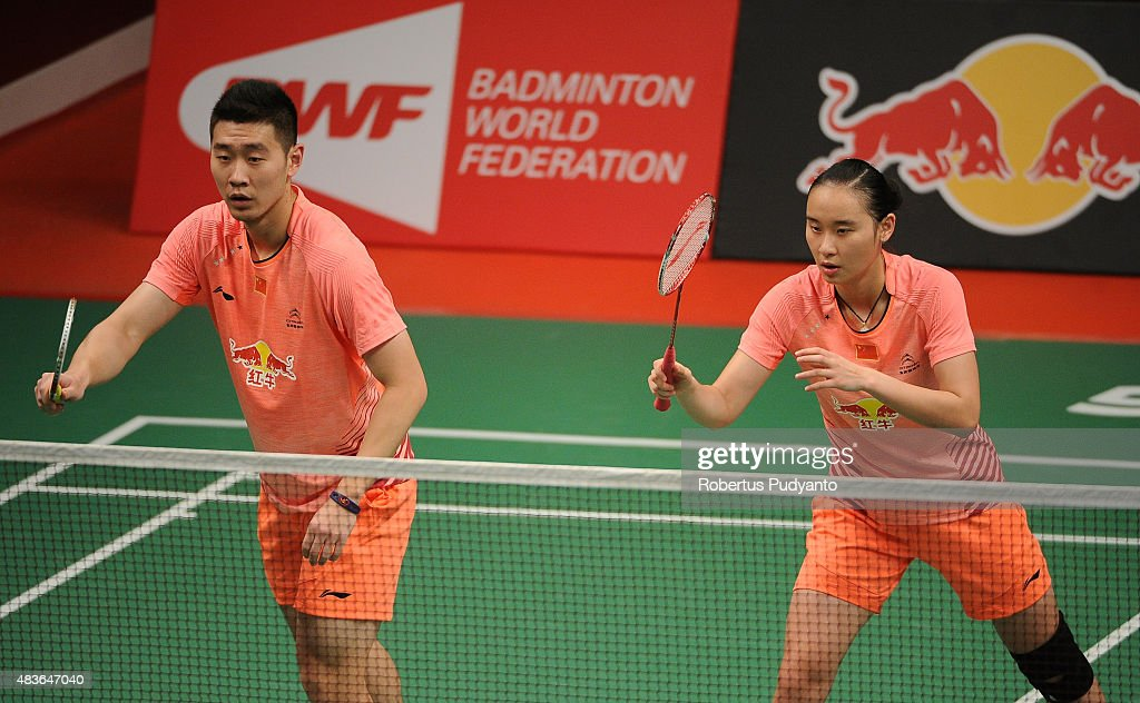 Liu Cheng and <a gi-track='captionPersonalityLinkClicked' href=/galleries/search?phrase=Bao+Yixin&family=editorial&specificpeople=8308329 ng-click='$event.stopPropagation()'>Bao Yixin</a> of China compete against Kenichi Hayakawa and Misaki Matsutomo of Japan in the 2015 Total BWF World Championship at Istora Senayan on August 11, 2015 in Jakarta, Indonesia.