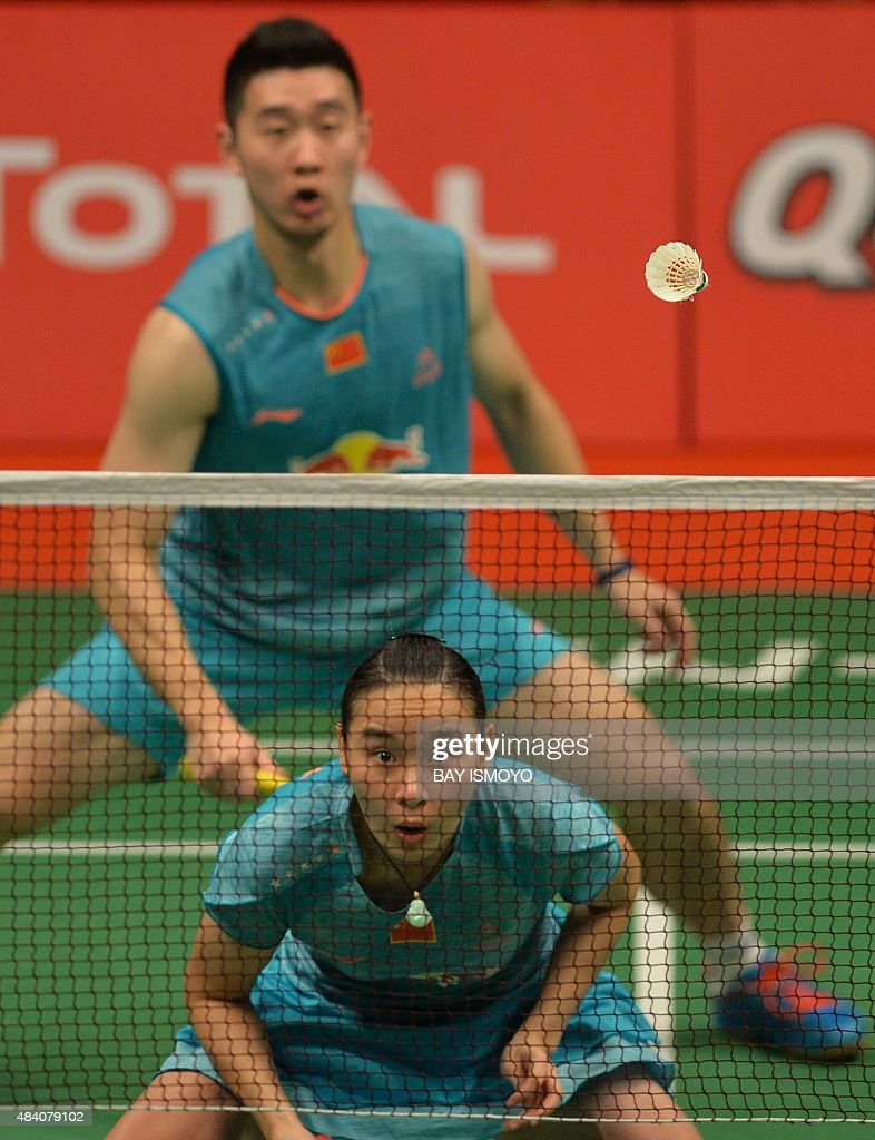 Liu Cheng back and Bao Yixin front of China hit a return
