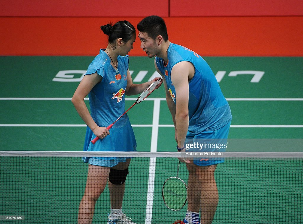 Liu Cheng and <a gi-track='captionPersonalityLinkClicked' href=/galleries/search?phrase=Bao+Yixin&family=editorial&specificpeople=8308329 ng-click='$event.stopPropagation()'>Bao Yixin</a> of China react after defeating Xu Chen and Ma Jin of China in the semi final match of the 2015 Total BWF World Championship at Istora Senayan on August 15, 2015 in Jakarta, Indonesia.