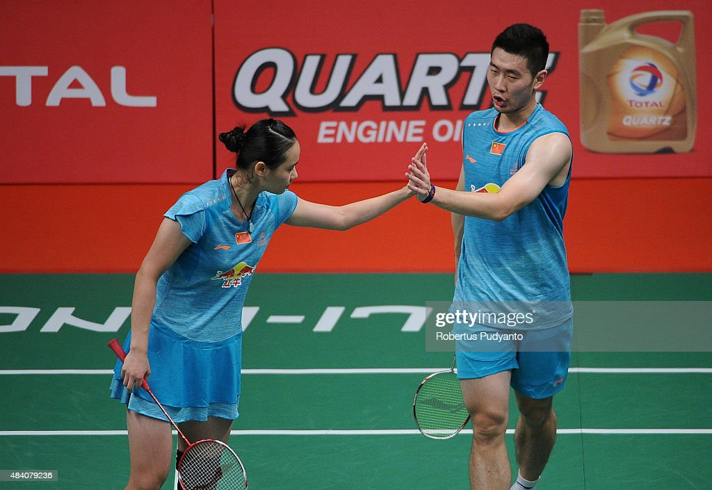 Liu Cheng and <a gi-track='captionPersonalityLinkClicked' href=/galleries/search?phrase=Bao+Yixin&family=editorial&specificpeople=8308329 ng-click='$event.stopPropagation()'>Bao Yixin</a> of China react against Xu Chen and Ma Jin of China in the semi final match of the 2015 Total BWF World Championship at Istora Senayan on August 15, 2015 in Jakarta, Indonesia.