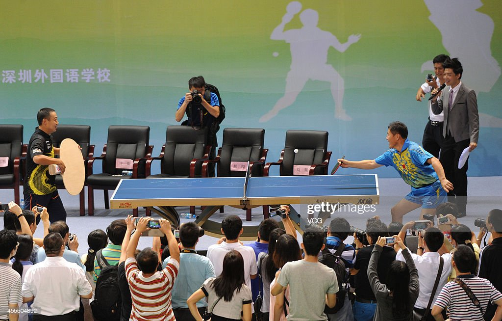 <a gi-track='captionPersonalityLinkClicked' href=/galleries/search?phrase=Liu+Guoliang&family=editorial&specificpeople=655363 ng-click='$event.stopPropagation()'>Liu Guoliang</a>, the head coach of the China's National Men's Team, plays table tennis by using a giant racket with his teacher on September 15, 2014 in Shenzhen, Guangdong province of China.