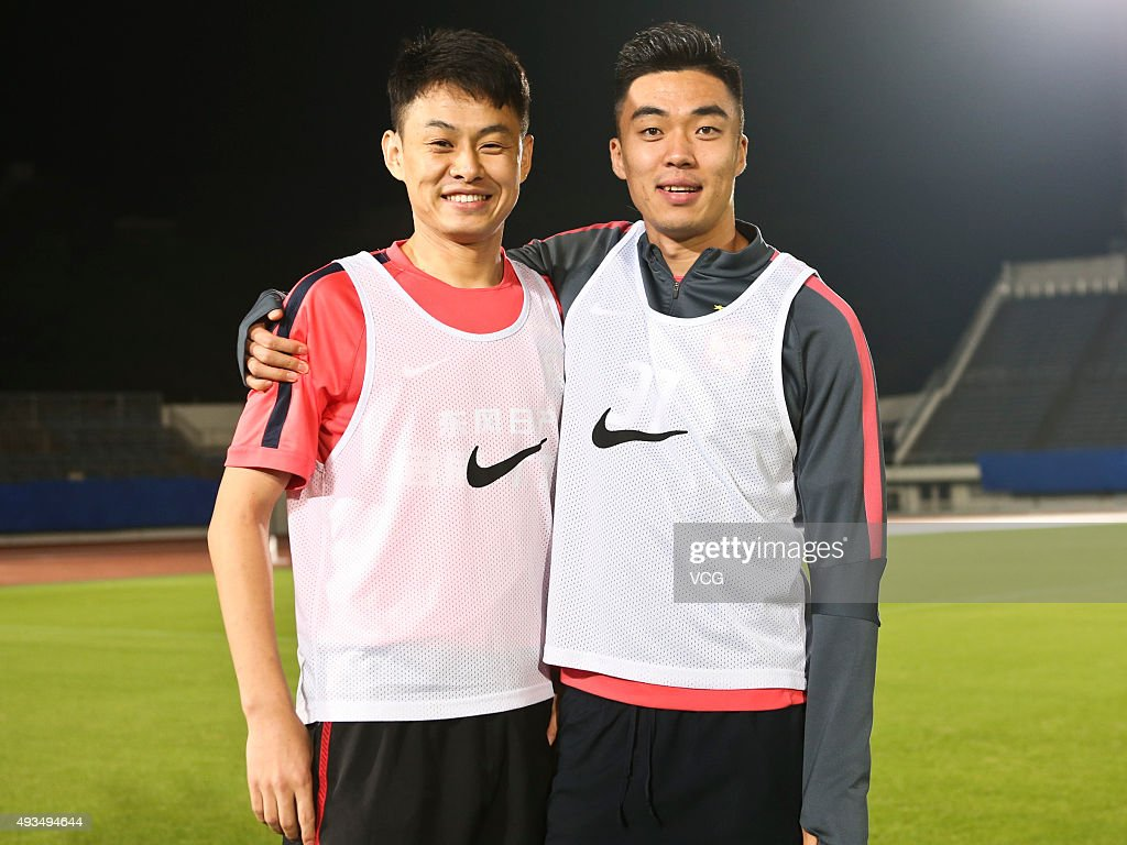 Liu Jian (L) and <a gi-track='captionPersonalityLinkClicked' href=/galleries/search?phrase=Zhao+Xuri&family=editorial&specificpeople=596391 ng-click='$event.stopPropagation()'>Zhao Xuri</a> of Guangzhou Evergrande pose during a training ahead of the semi finals match between Gamba Osaka and Guangzhou Evergrande as part of 2015 Asian Champions League on October 20, 2015 in Osaka, Japan.