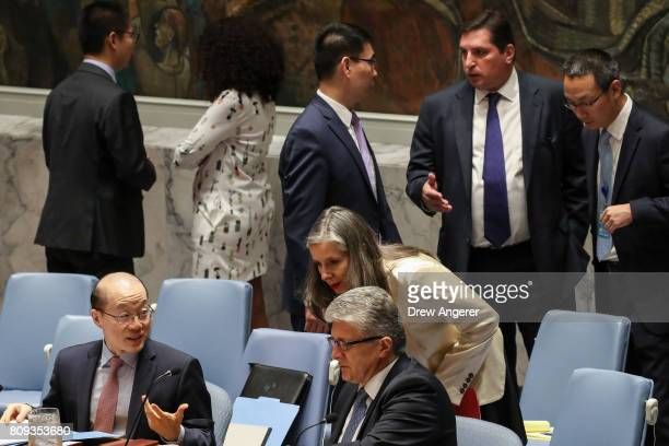Liu Jieyi Chinese ambassador to the United Nations speaks to Miroslav Jenca UN Assistant SecretaryGeneral for Political Affairs as Russian Deputy...