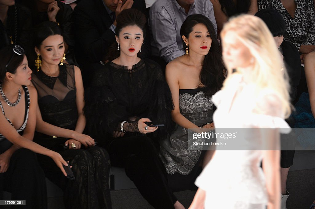 Liu Mei Ren, Jiang Xin and Zeng Li attend the Tadashi Shoji Spring 2014 fashion show during Mercedes-Benz Fashion Week at The Stage at Lincoln Center on September 5, 2013 in New York City.