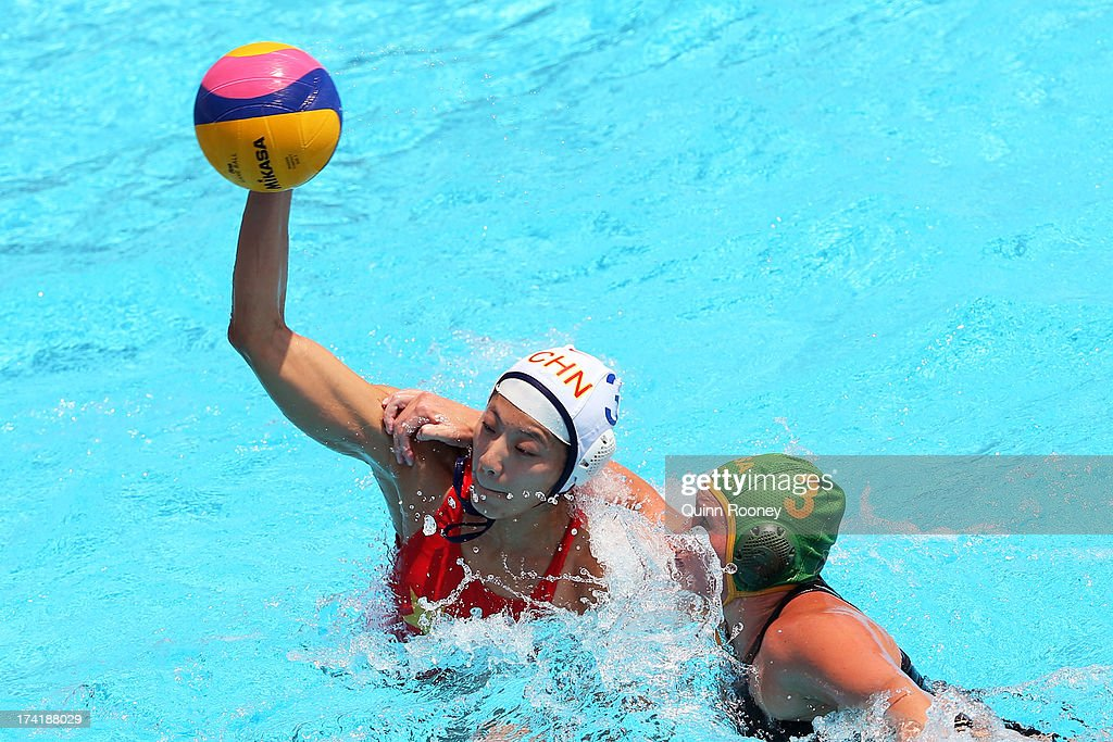 Liu Ping of China in action with Kieran Paley of South Africa during the Women's Water Polo first preliminary round match between China and South Africa during Day Two of the 15th FINA World Championships at Piscines Bernat Picornell on July 21, 2013 in Barcelona, Spain.
