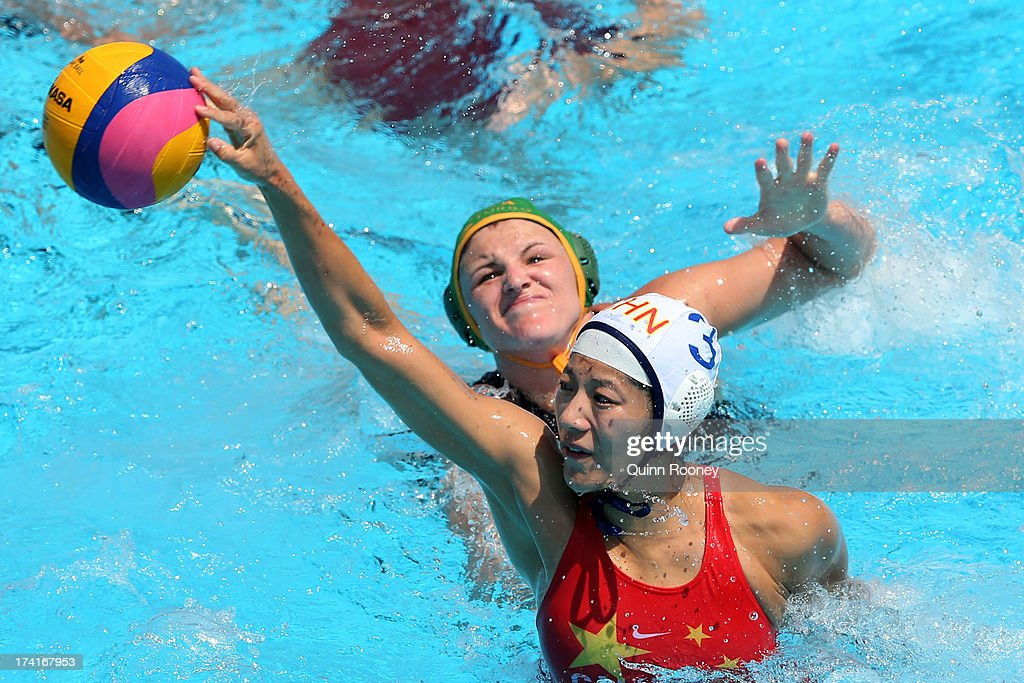 Liu Ping of China passes the ball under pressure during the Women's Water Polo first preliminary round match between China and South Africa during Day Two of the 15th FINA World Championships at Piscines Bernat Picornell on July 21, 2013 in Barcelona, Spain.